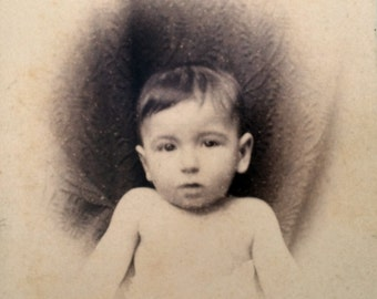 The Antique photograph of a baby from the 1800s. Victorian photograph.