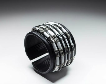 Black and white leather cuff bracelet with metal elements