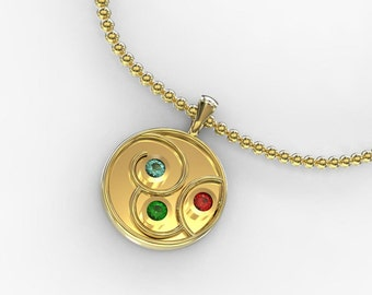 solid gold disc pendant with gemstones