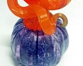 Purple blown pumpkin with orange stem!