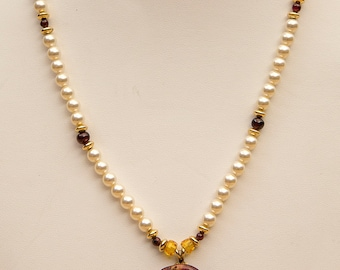 A Pearl and Deep Purple Spiny Oyster Necklace