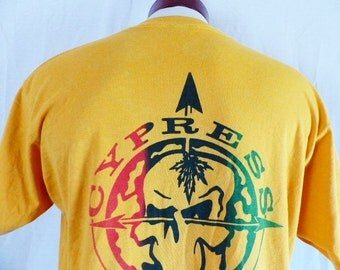 vintage 90's Cypress Hill yellow gold graphic t-shirt gradient red black green skull and arrow logo back print hip hop rap metal unisex XL