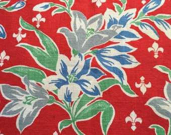 Vintage bright red feedsack  the colors are rich and vibrant red, blue and greens with fleur-de-lis