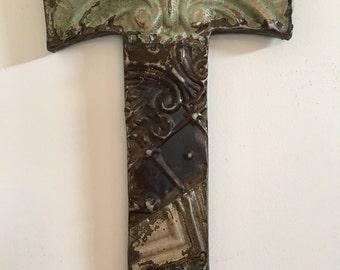 "Patchwork letter ""T"" designed with antique tin ceiling tile"