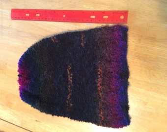 Rainbow slouchy hat hand knitted with boucle yarn number 22