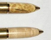 More 50 Cal machine gun brass cartridge pens with turned top of various woods, great if you like big guns!  Cool Groomsman's gifts!