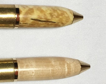 More 50 Cal machine gun brass cartridge pens with turned top of various woods, great if you like big guns!  Cool Groomsman gifts!