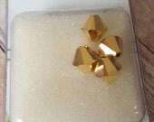 4 Crystal Aurum 2x Swarovski Crystals New in package