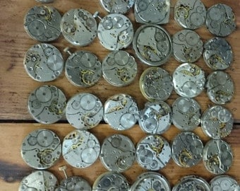 Lot of 36 vintage mechanical watch movements, watch parts mixed media jewelery lot, movements