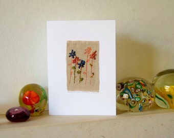 Embroidery & block printed greeting card in linen with a flowery design.