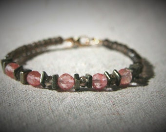 Jenna Stacking Bracelet: Delicate faceted smoky quartz and cherry quartz beads accented with smooth pyrite and 14k gold filled lobster clasp