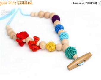 25% off Eco-Friendly Rainbow Teething necklace/Breastfeeding mom necklace.Crochet Nursing necklace with wooden button.