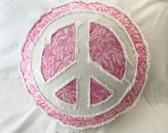Peace sign boho pillow light pink batik with tropical leaf design and distressed off-white denim round pillow