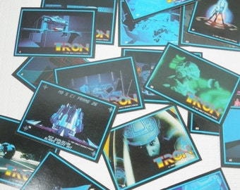 On Sale Price Tron Trading Cards. Flynn and Tron Outsmart  Master Controller While Riding Light Cycles on The Grid. Unforgettable Science Fi