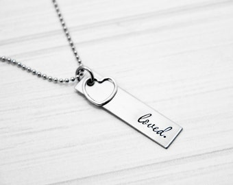 Loved - Hand Stamped Necklace - Stainless Steel Tag with Sterling Silver Heart Charm - Can be personalized by request