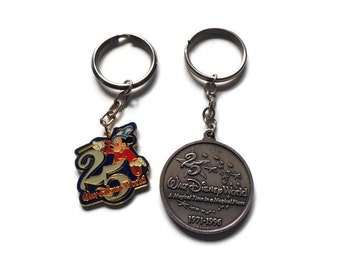 Walt Disney Key Chains, Twenty- Fifth Anniversary...Two Novelty Key Chains....1971-1996