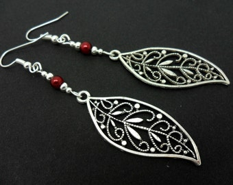 A pair of pretty tibetan silver & red bead  leaf themed long dangly earrings.