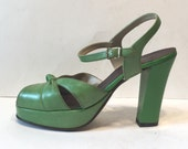 size 8 / 1970s green vinyl platforms