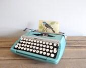 Turquoise Smith-Corona Corsair Deluxe Portable Typewriter