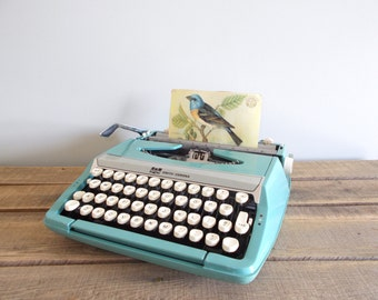 Turquoise Smith-Corona Corsair Deluxe Portable Typewriter