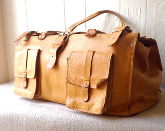 Brown leather duffel bag, leather travel bag, 1970s duffel bag, leather weekender bag, vintage luggage.