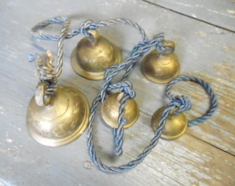 Enchanting Musical Graduated Collection of 5 Tinkling Ornate Etched Brass Bells Vintage From India Mounted on Cording Wind Chime Door Alarm