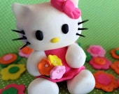 "Fondant ""Hello Kitty"" inspired cake topper with 25 fondant flowers for decorating your cake and/or cupcakes, fondant kitty, kitty cupcake"