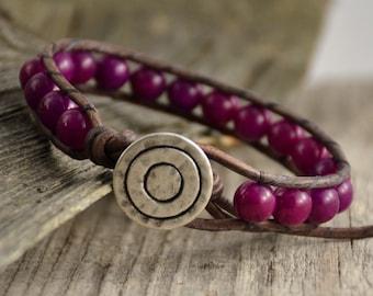 Purple beaded leather wrap bracelet. Beaded boho jewelry