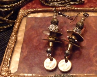 Steampunk gears and other clock parts chandelier earrings