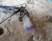 Beautifful Amythest crystal point wire wrapped in ab seed beads