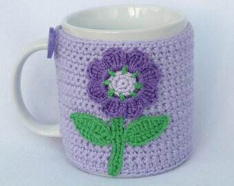 Lilac crochet mug cozy with flower applique