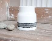 """Hand-painted milk jug """"somewhat angular"""", black and white"""
