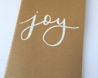 Joy Embossed Blank Large Moleskine Journal