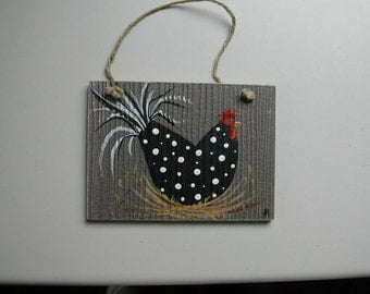 Chicken in black with white polka dots