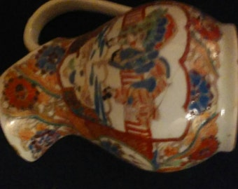 """Antique Japanese Imari Pitcher 5.5"""" tall 5"""" wide 3"""" diameter base Old repair with staples"""