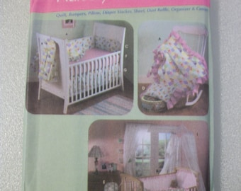 Simplicity 4627 Nursery Accessories such as crib quilt, crib bumpers, crib pillow, diaper stacker, sheet, dust ruffle, organizer, canopy