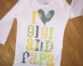 Personalized, appliqued baby onesie in pastels