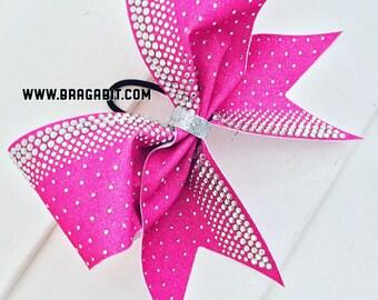 Sublimated pink glitter with multisize rhinestones .