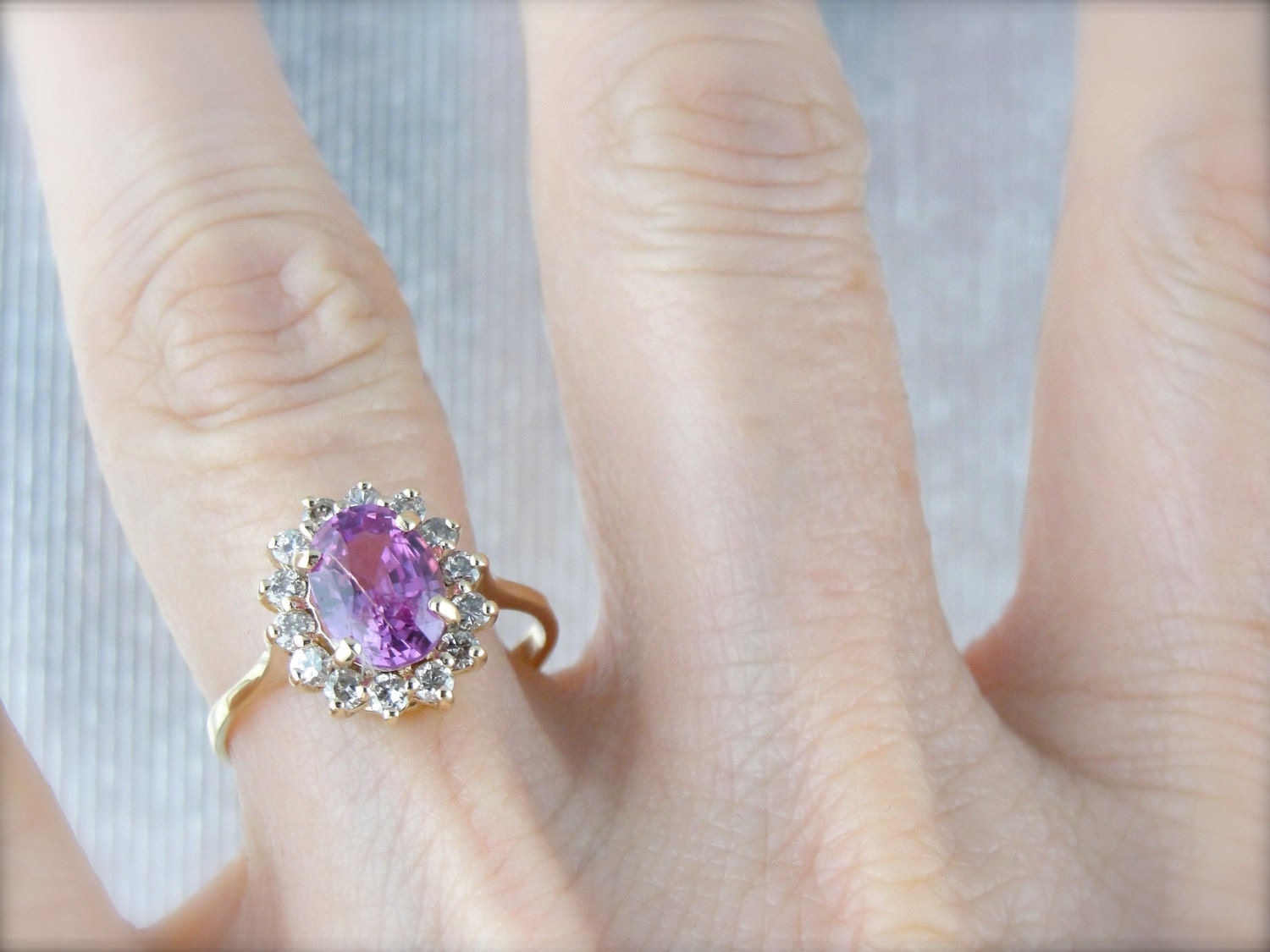 Pink sapphire halo anniversary ring yellow gold and gorgeous