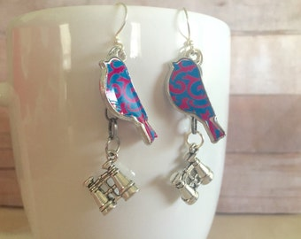 Bird watching earrings. Binoculars and a colorful bird charm.
