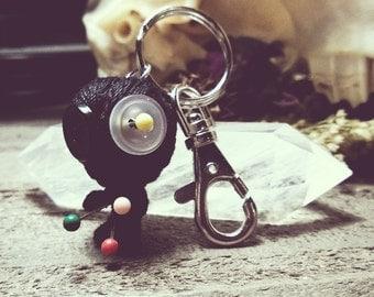 string doll key chain