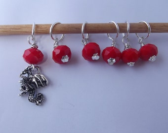 Here be DRAGONS! Six(6) stitch Markers featuring red beads and marker with a dragon.
