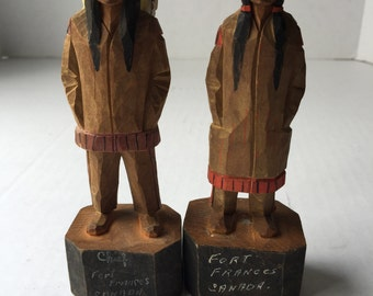 2 wooden native american carvings