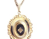 Black and gold crest pendant necklace