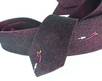 Vintage classic Don Draper style skinny necktie in a textured speckled design. Pink and black with great mid tie icon detail