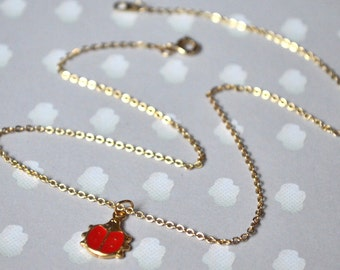 Gold pendant necklace red ladybug