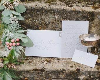 Elegant calligraphy wedding invitation in palest grey