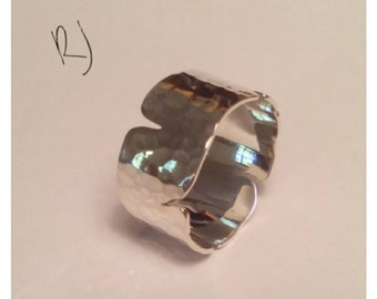 Wide silver fracture ring.
