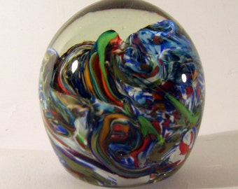Layered and Undulating interior Paperweight in many colors