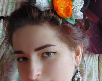 Orange pin up style rose fascinator with lace ideal for Halloween